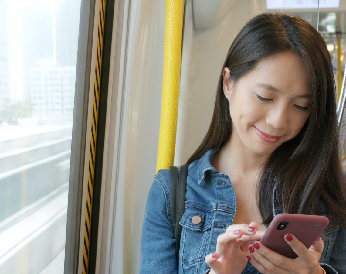 Woman use of cellphone in train
